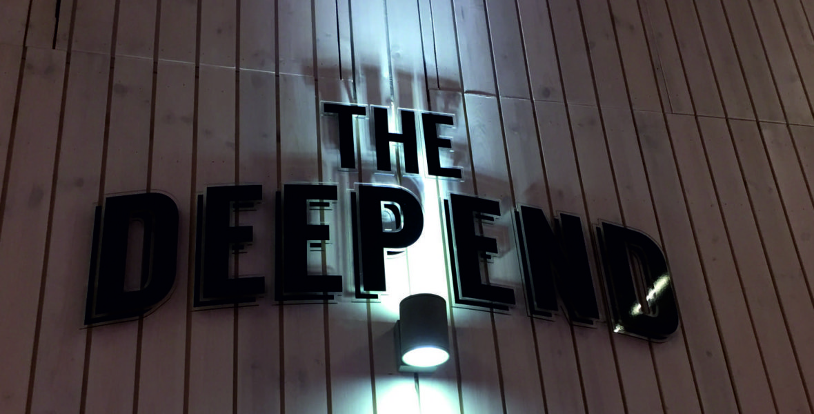 the deep end backlit wall sign